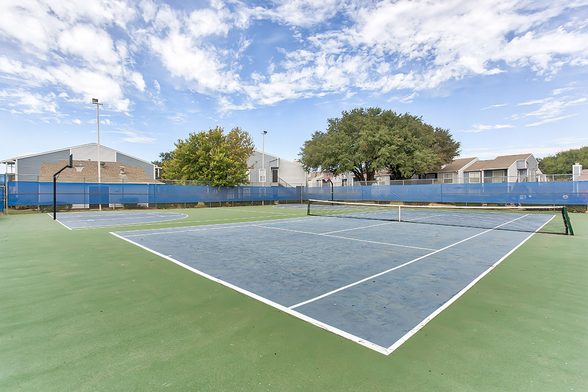 Tennis & Basketball Court at Indian Run Apartments in Abilene, TX