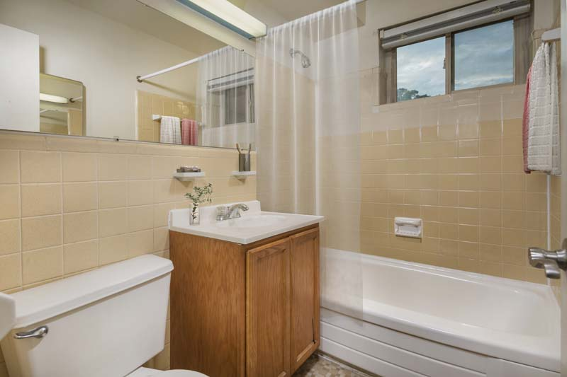 Bath with tile surround at Iverson Towers & Anton House Apartments