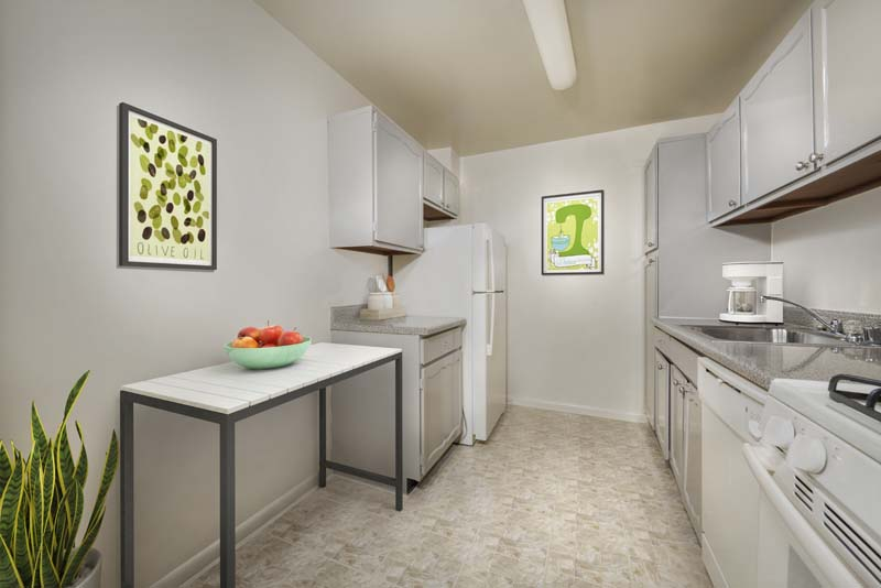 Fully-equipped kitchen at Iverson Towers & Anton House apartments in Temple Hills, MD