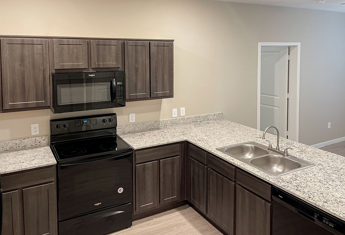 Kitchens with Granite Countertops at Jubliee at Texas Parkway Apartments in Missouri City, Texas