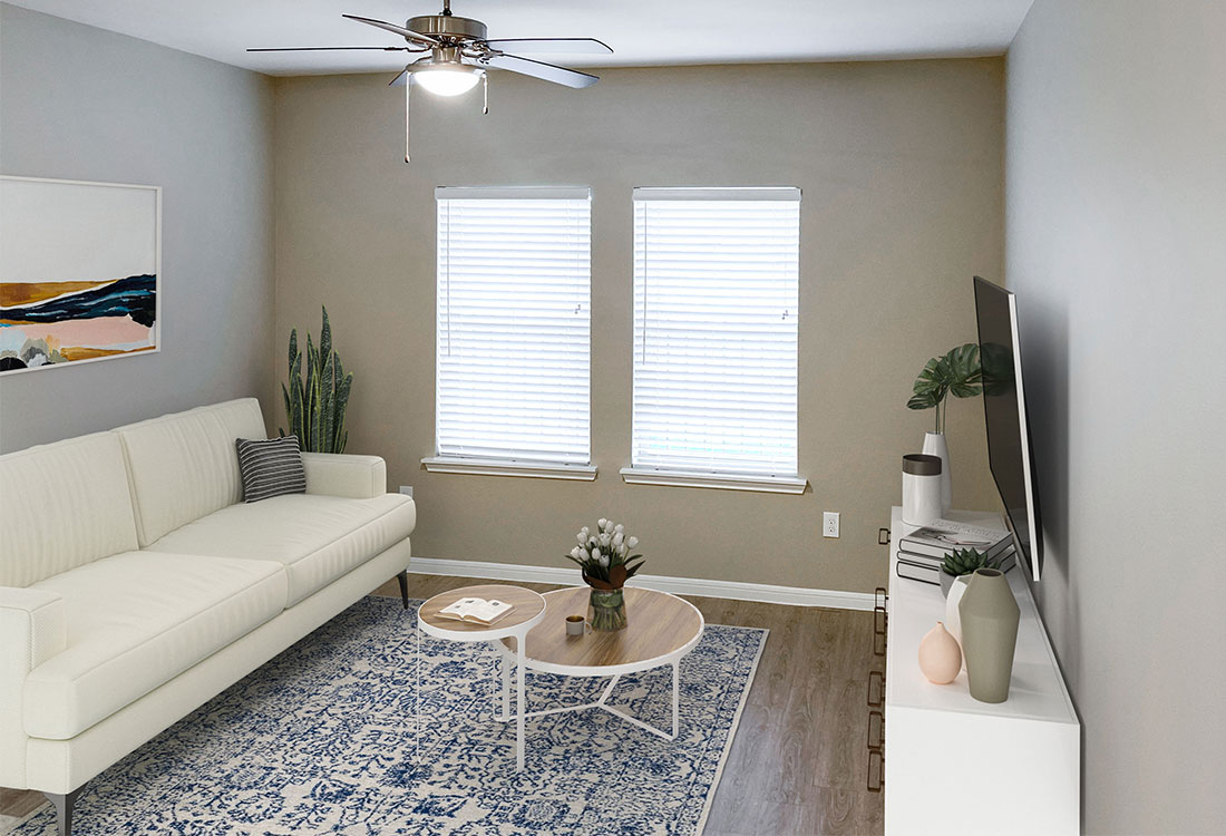 Living Room with Plank Flooring at Jubliee at Texas Parkway Apartments in Missouri City, Texas
