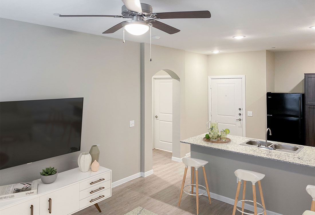 Living & Kitchen Areas at Jubliee at Texas Parkway Apartments in Missouri City, Texas