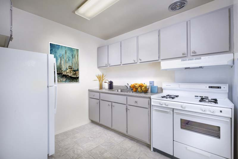Kitchen with gas range at Kenilworth Towers Apartments in Bladensburg, MD
