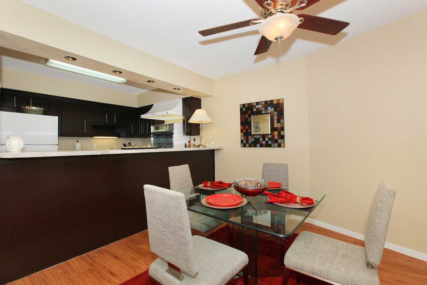 Separate Dining Areas with Retro Kitchen at View at Kessler Park Apartments in Dallas, TX