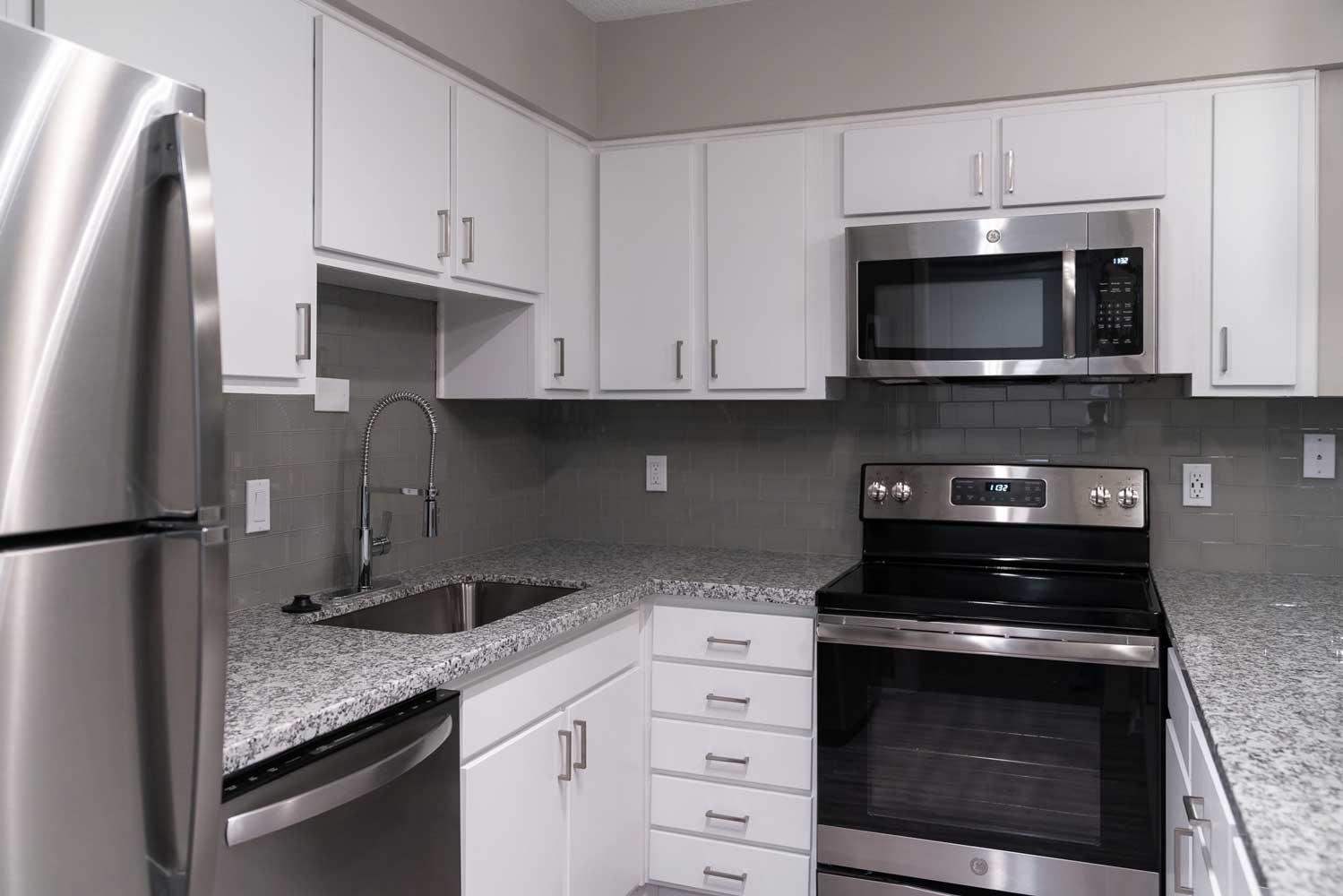 Newly Renovated Kitchens at View at Kessler Park Apartments in Dallas, TX