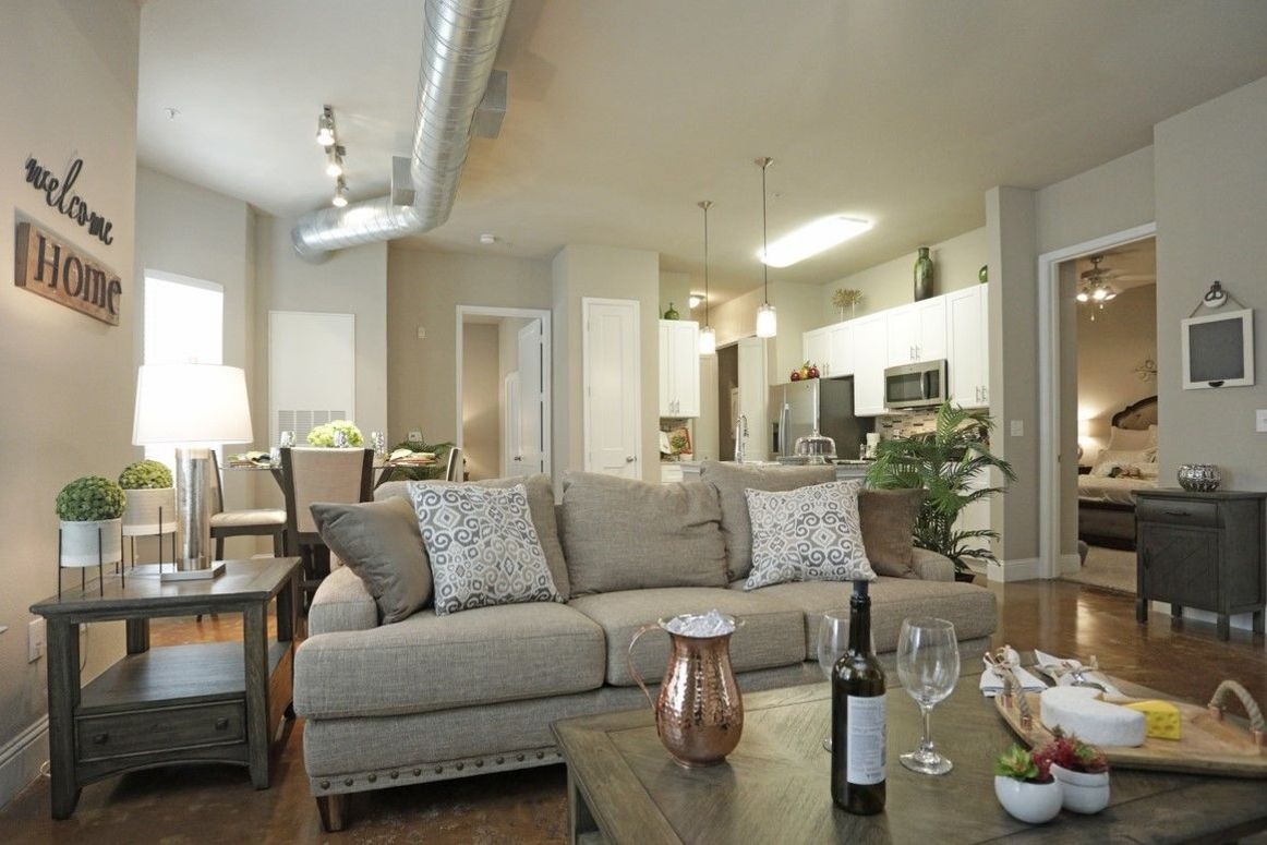 Spacious Living Room at King's Cove Apartments in Kingwood, Texas