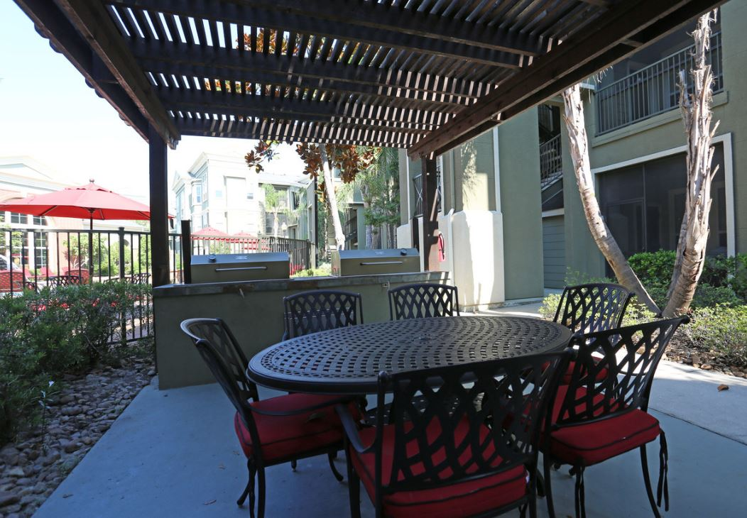 BBQ Grills Under Pergola at King's Cove Apartments in Kingwood, Texas