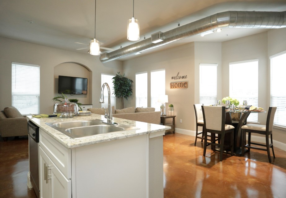 Kitchen Island with Sink at King's Cove Apartments in Kingwood, Texas