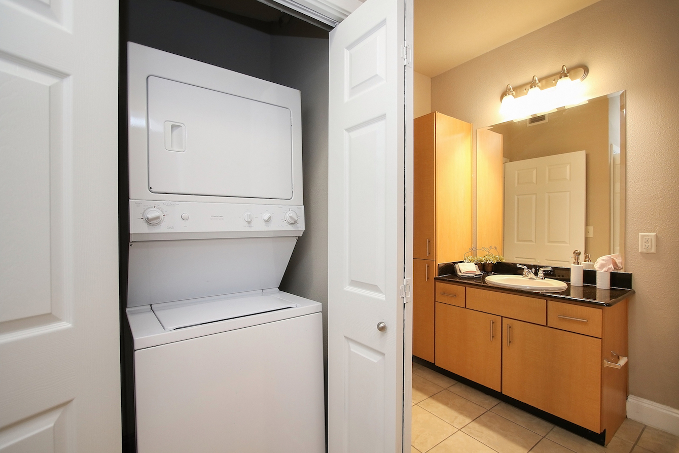 In-Unit Washer and Dryer at King's Cove Apartments in Kingwood, Texas