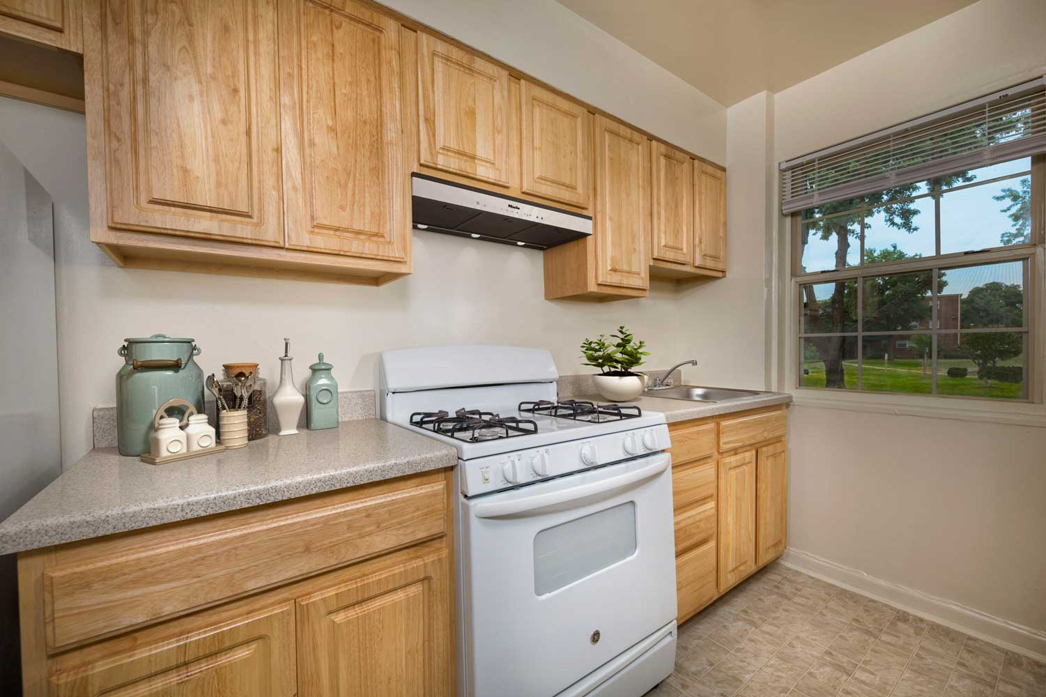Kitchen with all essentials at Kirkwood Apartments in Hyattsville, MD
