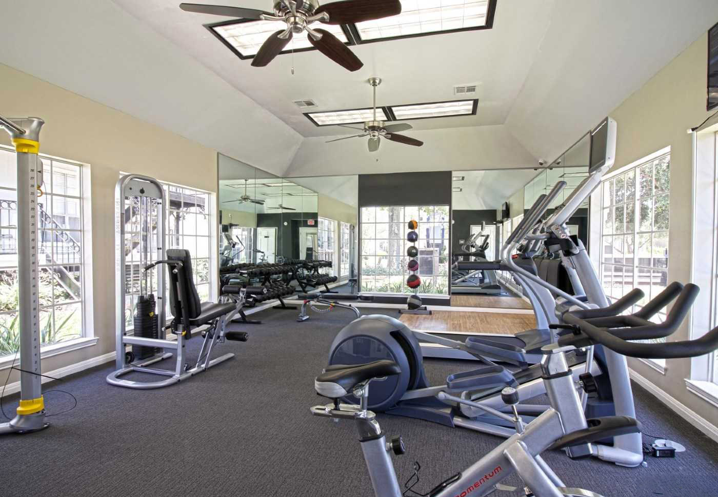 Professional Free Weight Equipment at Grove at Seabrook Apartments in Seabrook, Texas