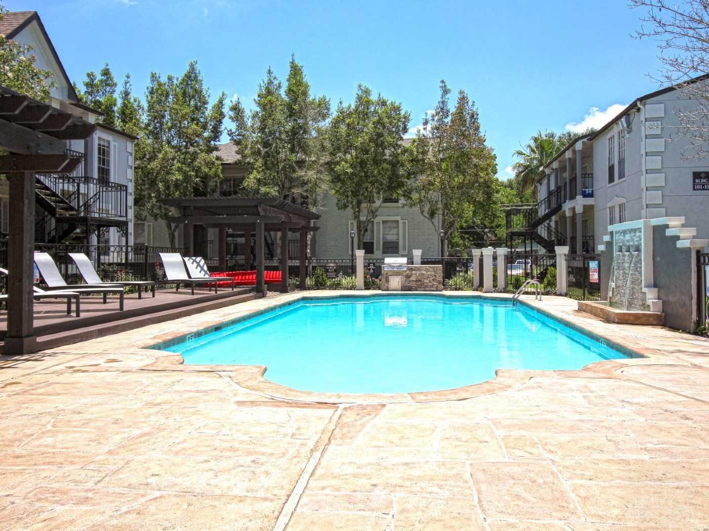 Pool Lounge Area at La Maison at Lake Cove Apartments in Seabrook, Texas
