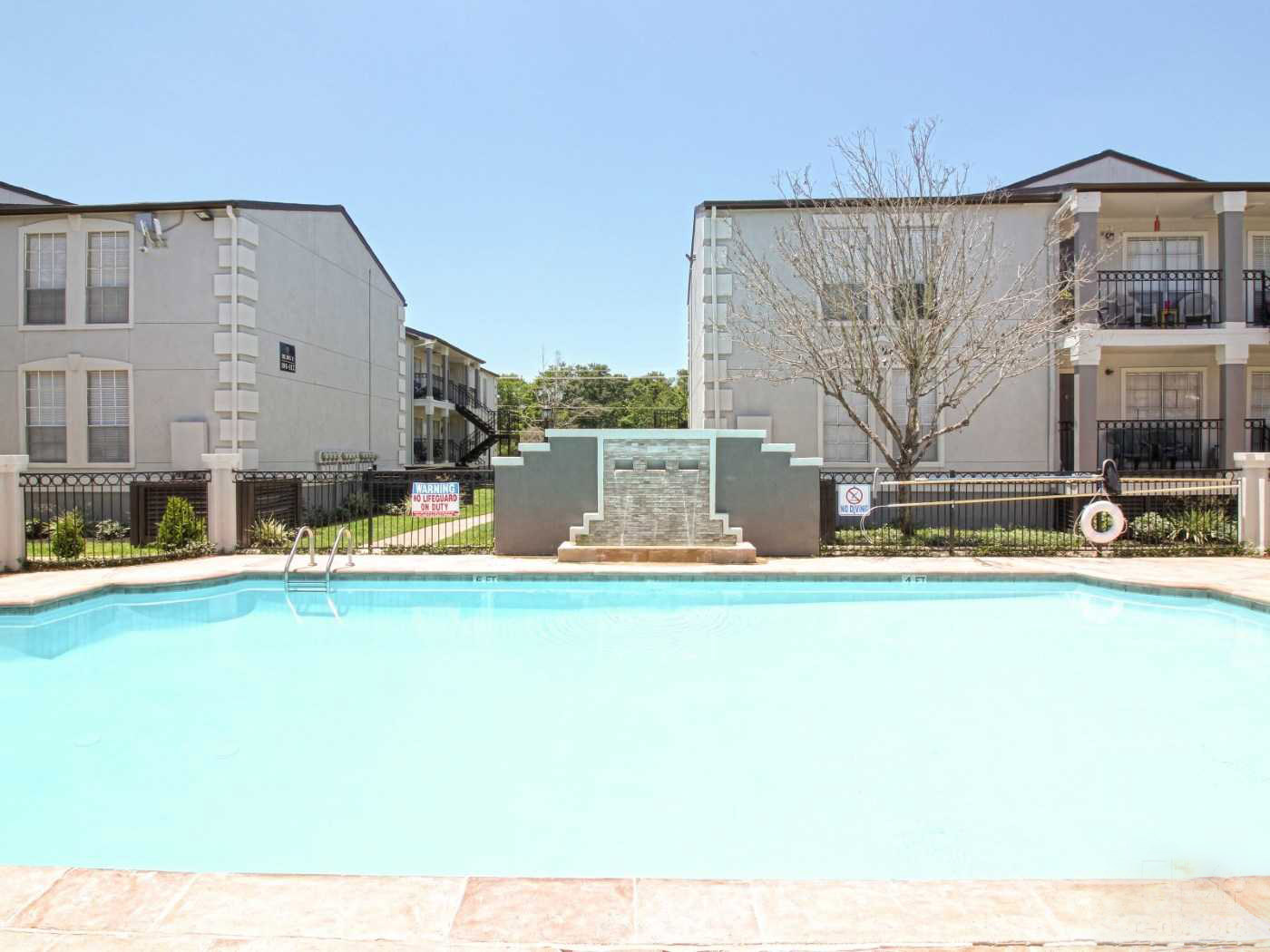 Pool with Waterfall at La Maison at Lake Cove Apartments in Seabrook, Texas