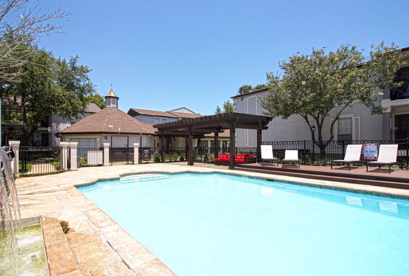 Gated Pool Area at Grove at Seabrook Apartments in Seabrook, Texas
