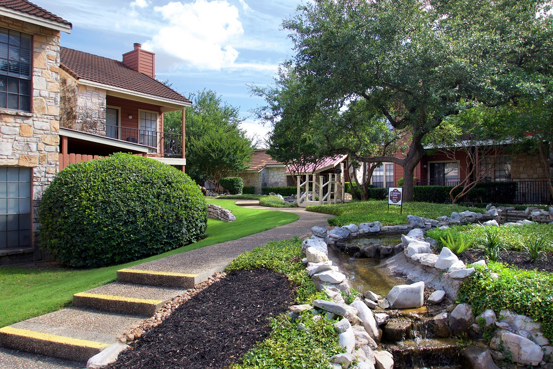Walking Trails with Man-Made Creek at Las Brisas Apartments in San Antonio, TX