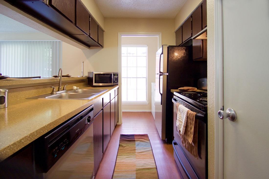 Galley Kitchen at Las Brisas Apartments in San Antonio, TX