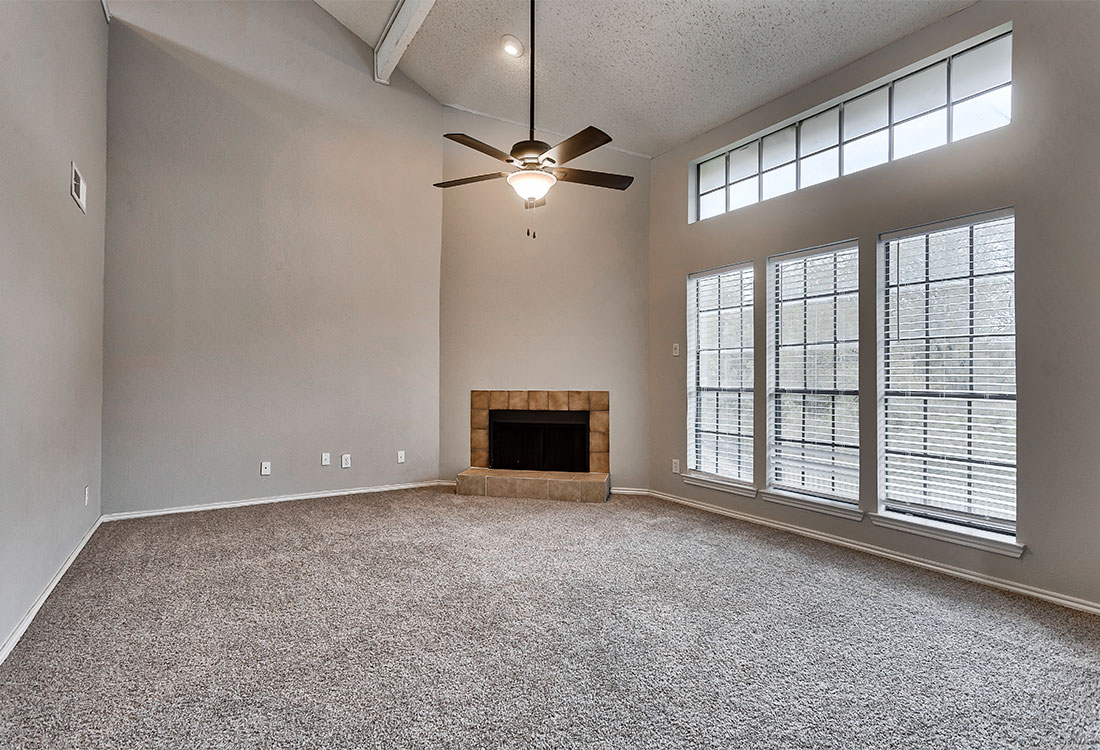 Living Room with Fireplace at Las Brisas Apartments in North Central San Antonio, TX