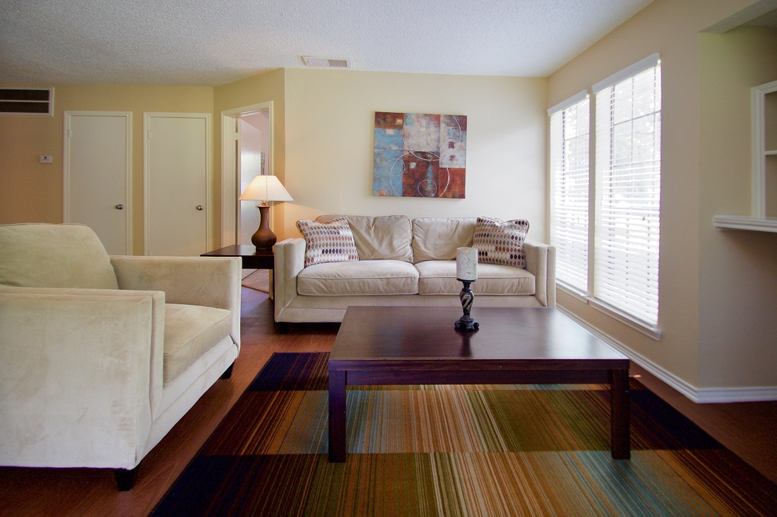Bright and Open Living Room at Las Brisas Apartments in San Antonio, TX