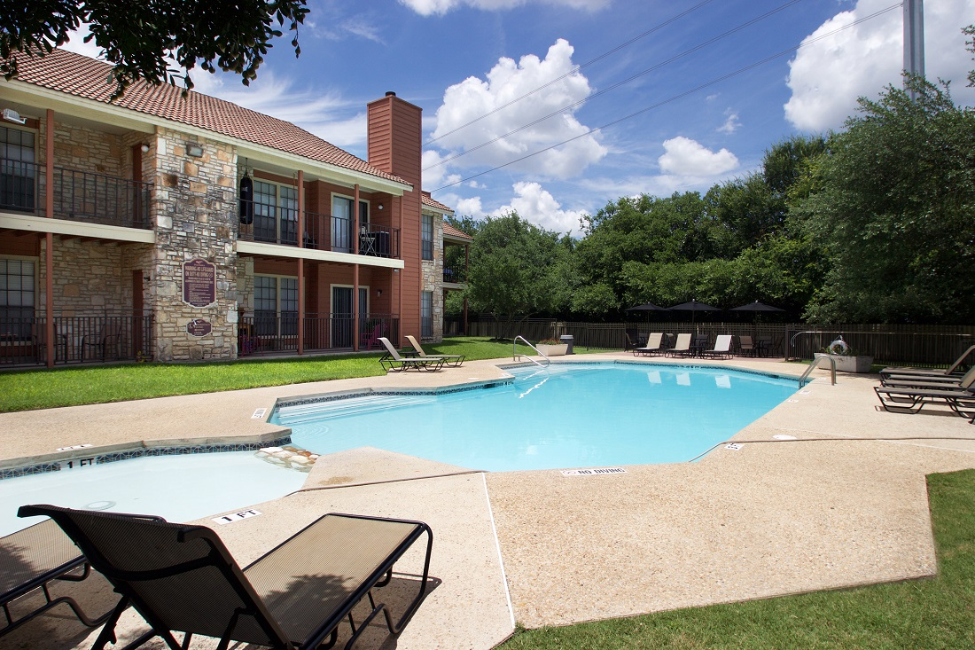 Pool Lounge Area at Las Brisas Apartments in San Antonio, TX
