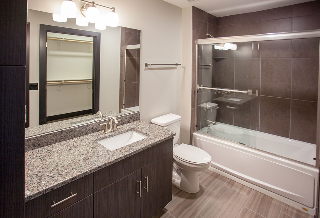 Bathroom with Shower and Tub Combination at Legacy Flats Apartments in Omaha, Nebraska