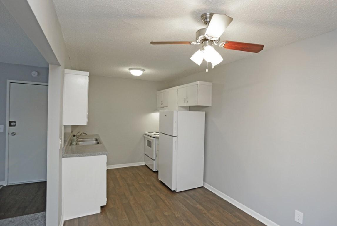 Kitchen with White Appliances at Liberty View Apartments in Liberty, MO