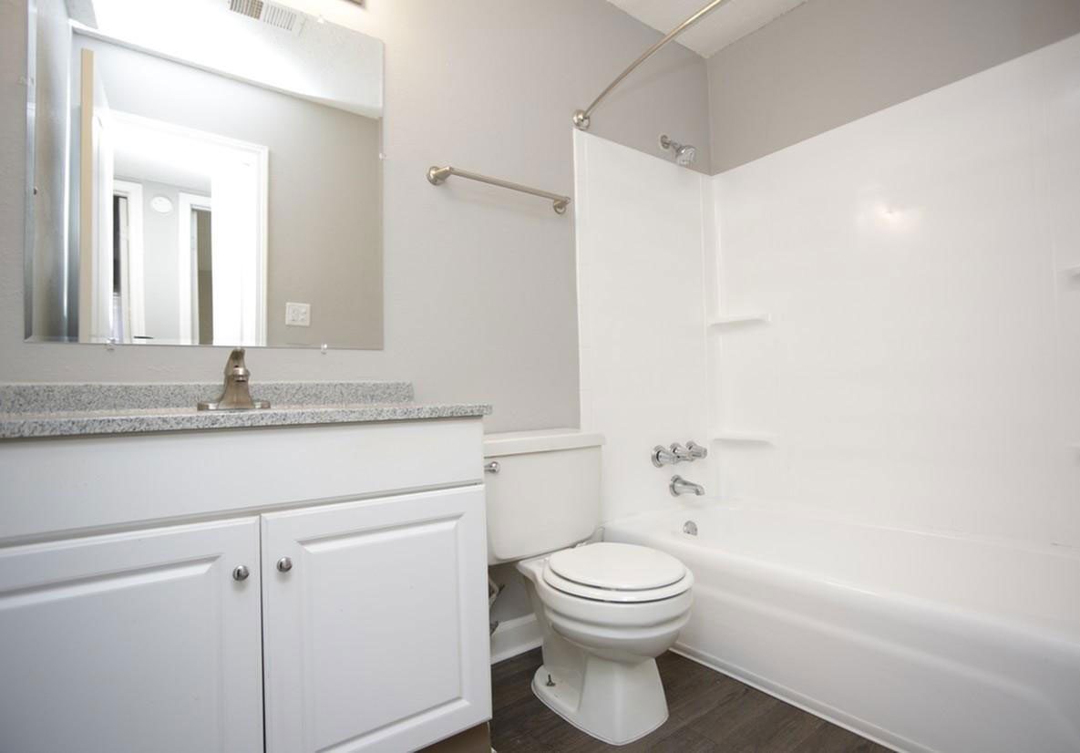 Sophisticated Bathroom at Liberty Heights Apartments in Liberty, MO