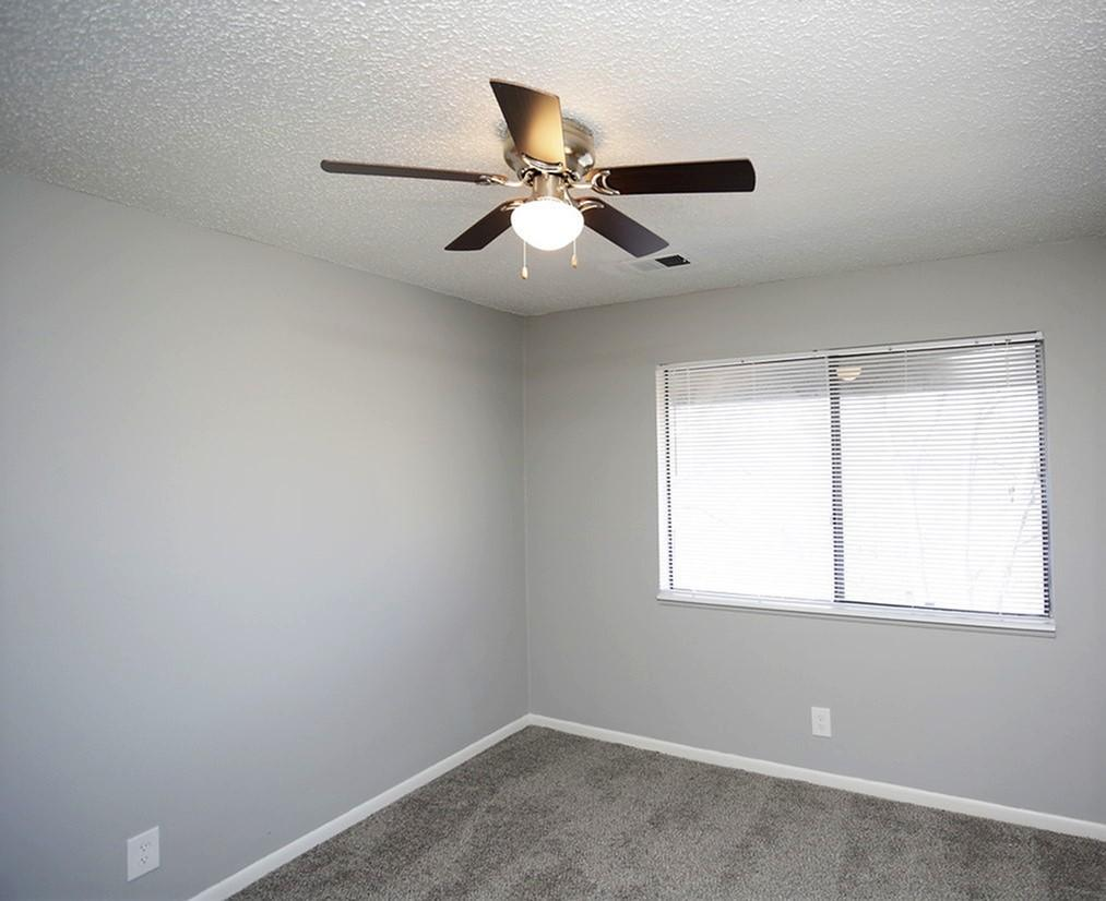 Bedrooms with Ceiling Fans at Liberty View Apartments in Liberty, MO