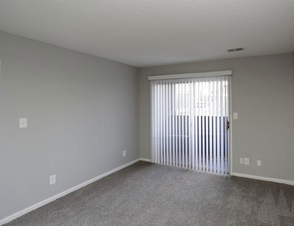 Private Balcony with Vertical Blinds at Liberty Heights Apartments in Liberty, MO