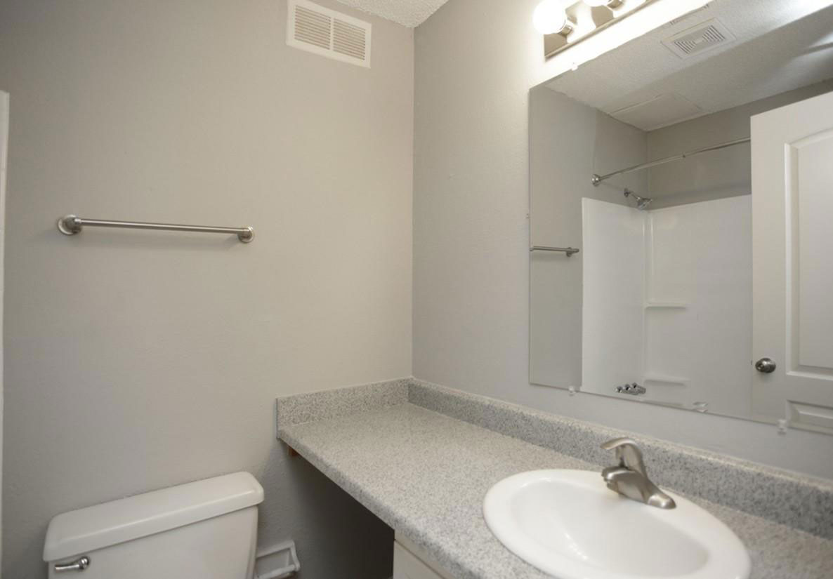Bathroom Vanity with Lighting at Liberty Heights Apartments in Liberty, MO