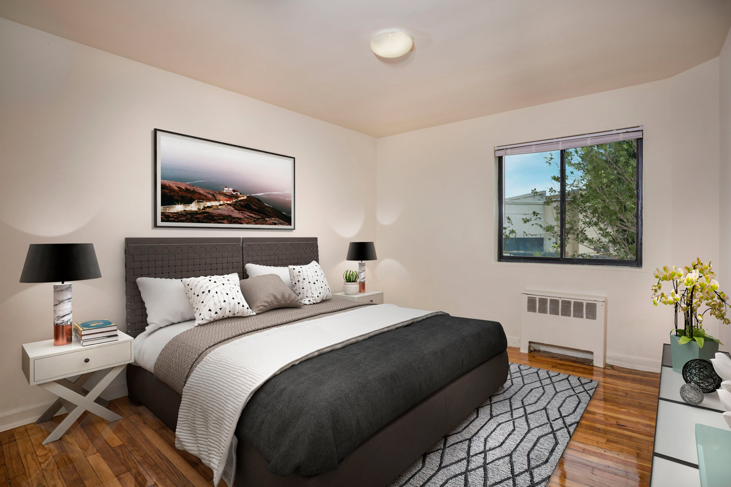 Cozy bedroom at Liberty Place Apartments in Langley Park, MD
