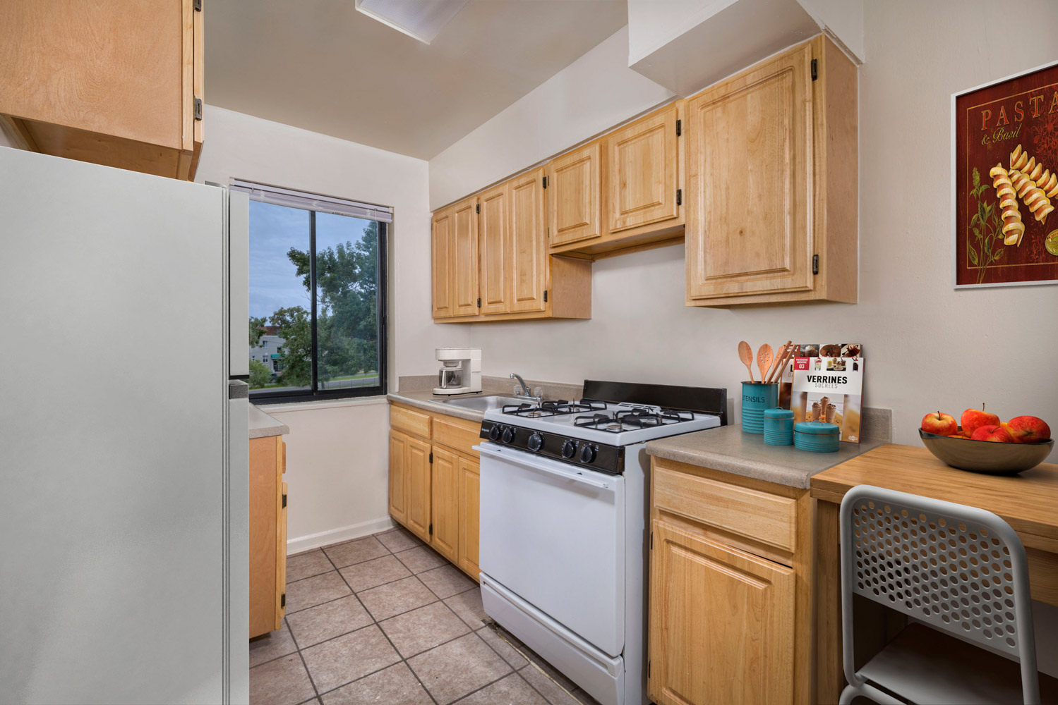 Kitchen with gas range at Liberty Place Apartments in Langley Park, MD