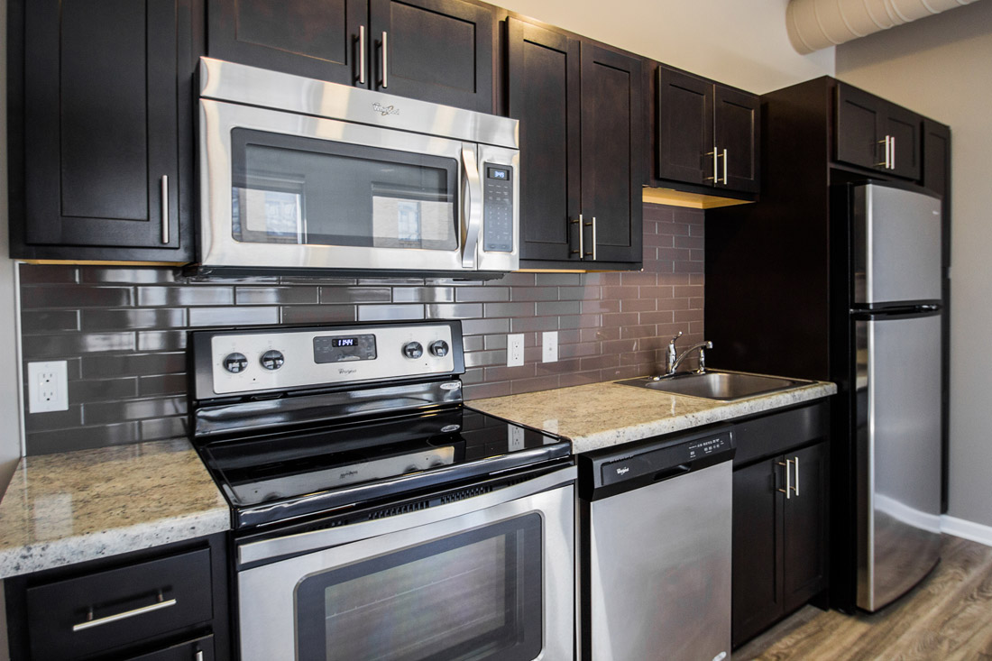 Ample Kitchen Cabinet Storage at Limelight at Sixteenth Apartments in Omaha, NE