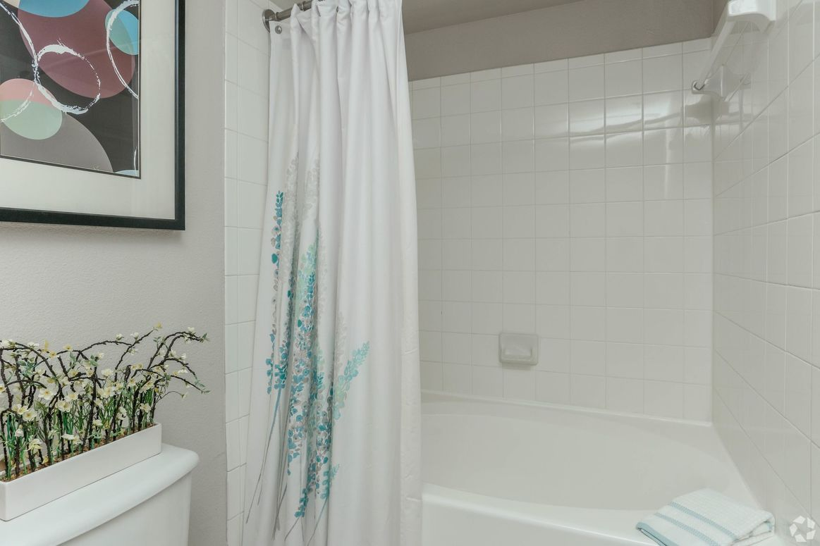 Tiled Bath and Shower at Limestone Apartments in Houston, Texas