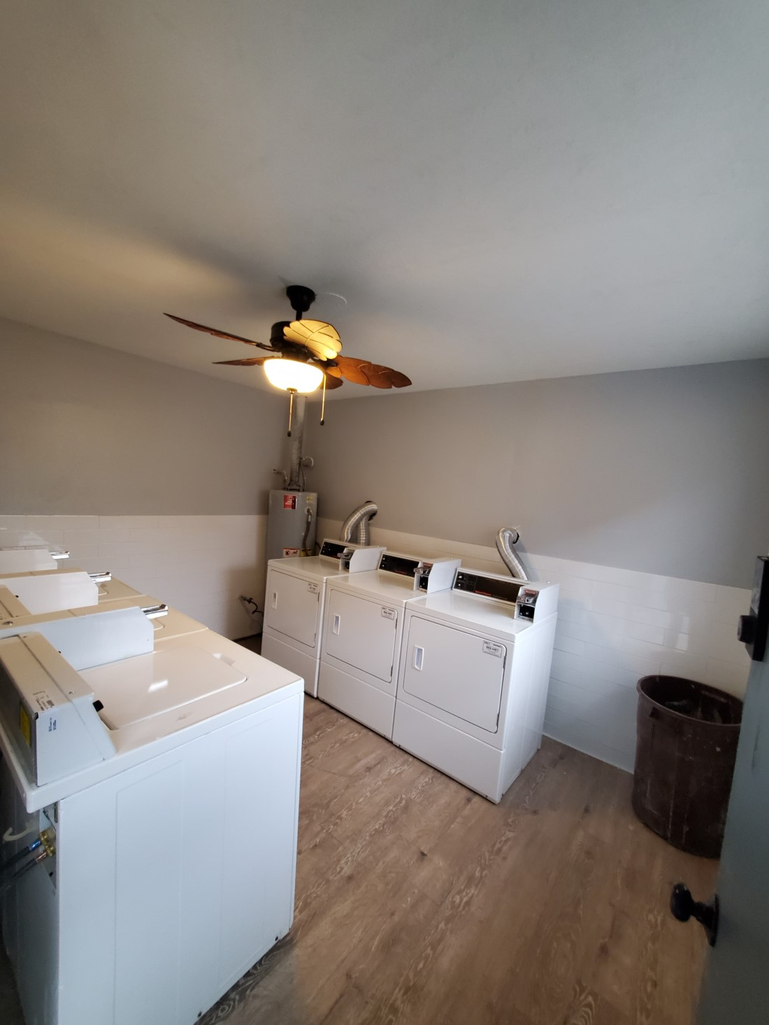 Modern Laundry Area at Live Oak Apartments in Huntsville, Texas