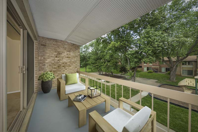 Spacious covered balcony at Londonderry Apartments in Gaithersburg, MD