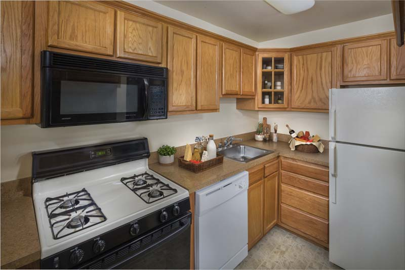 Fully-equipped kitchen at Londonderry Apartments in Gaithersburg, MD