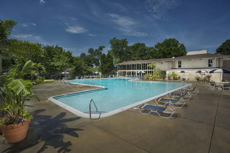 Refreshing outdoor pool with sundeck at Londonderry Apartments in Gaithersburg, MD