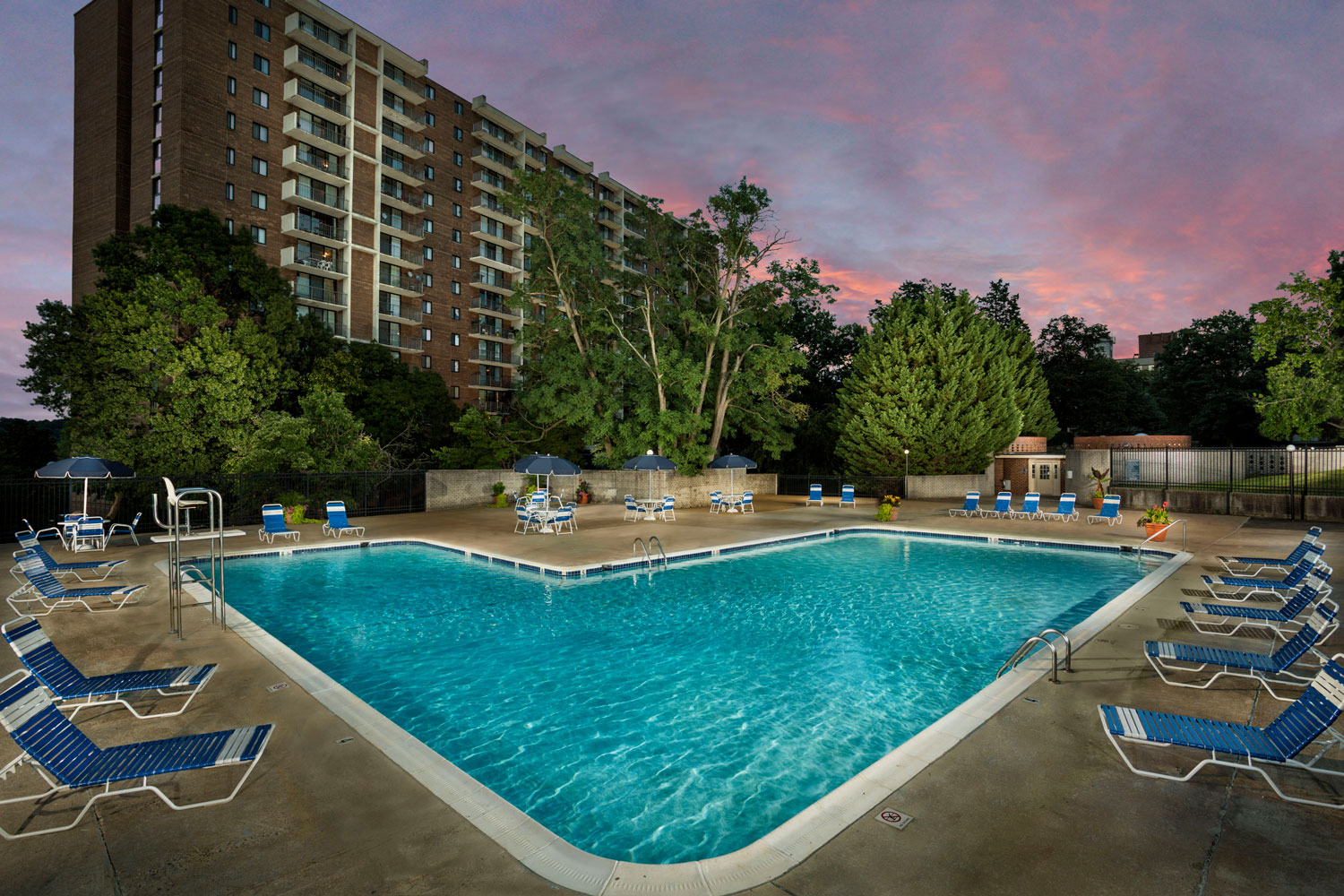 Relaxing swimming pool with sundeck at London Park Towers Apartments in Alexandria, VA