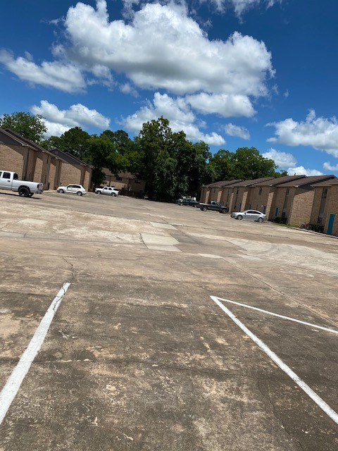Parking Lot at Magnolia Manor Apartments in West Columbia, Texas