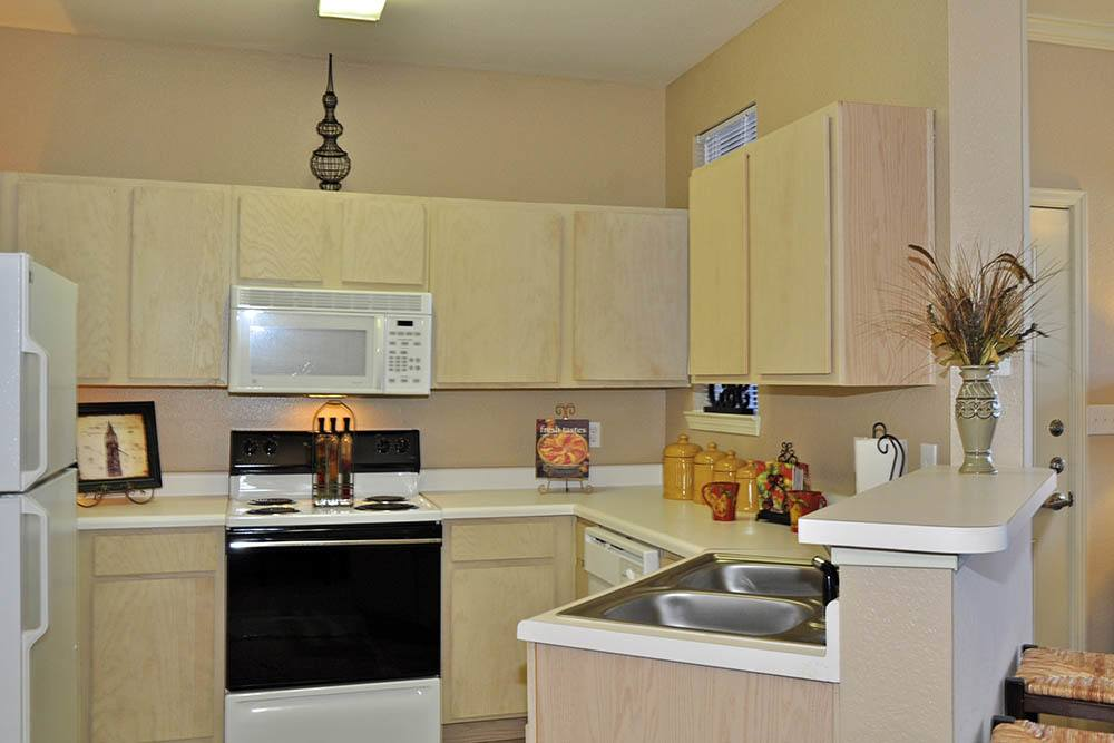 Kitchen Cabinetry at Magnolia Trace Apartments in Alexandria, Louisiana