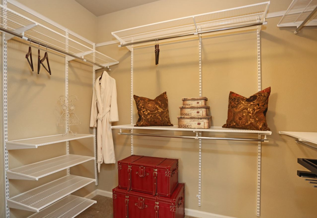 Walk-In Closets with Shelving at McDermott Crossing 55+ Apartments in Plano, Texas