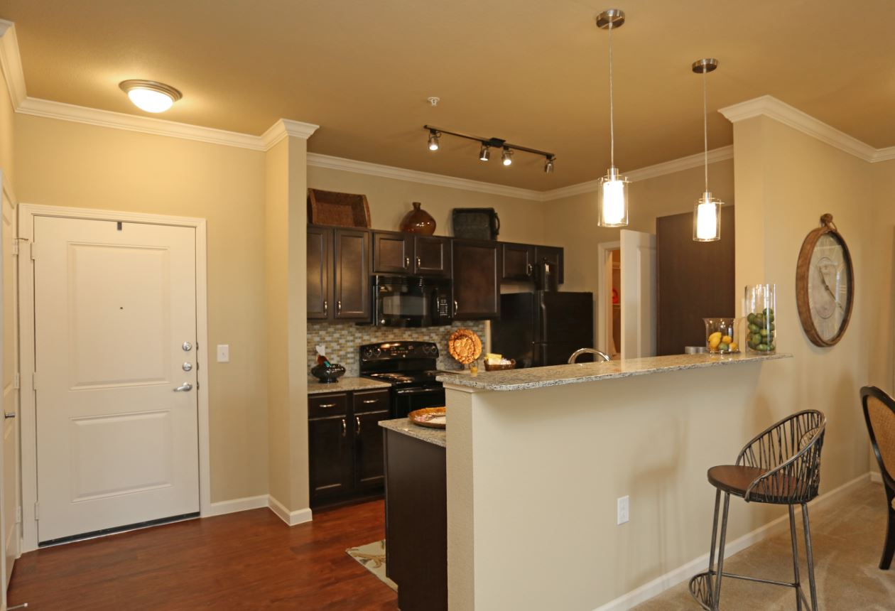 Kitchen Bar with Granite Counters at McDermott Crossing 55+ Apartments in Plano, Texas