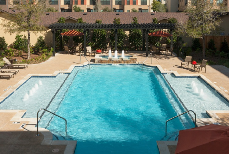 Sparkling Pool at McDermott Crossing Senior Apartments in Plano, TX