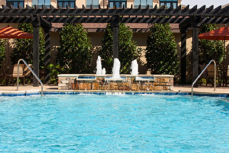 Resort-Style Pool At Mcdermott 55 Apartments In Plano, TX