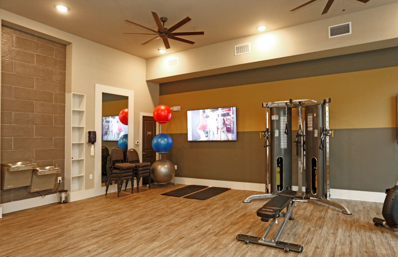Modern Fitness Center at McDermott Crossing 55+ Apartments in Plano, Texas
