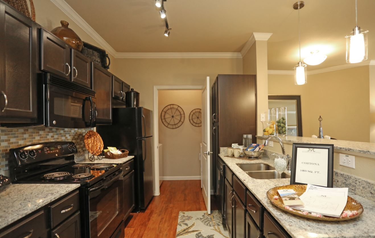 Fully-Equipped Kitchen at McDermott Crossing 55+ Apartments in Plano, Texas