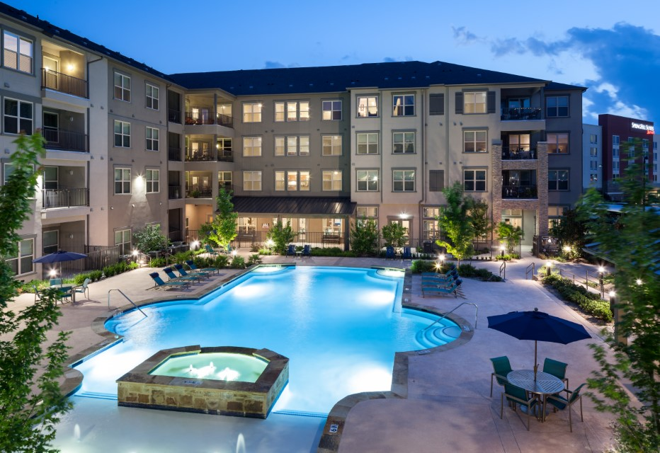 Exterior Building View & Pool At McDermott 55 Apartments In Plano, TX