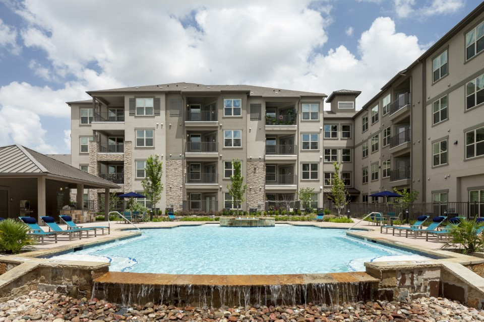 Resort-Style Swimming Pool At McDermott 55 Apartments In Plano, TX