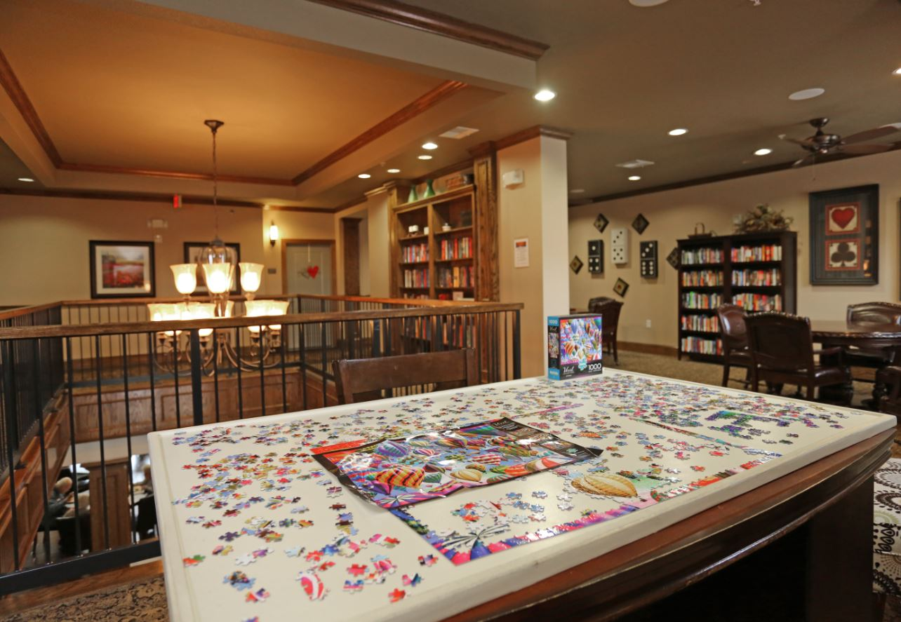 Game Room with Library at McDermott Crossing 55+ Apartments in Plano, Texas