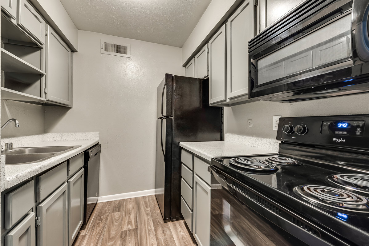 Spacious Kitchen at Mill House Apartments in Dallas, TX